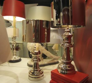 Love how these mirrored Barbara Cosgrove lamps pop against the accents of red!