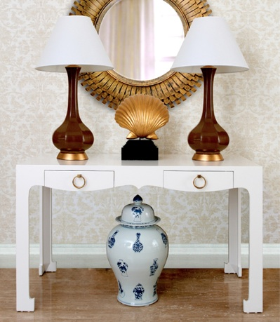 Here our Bungalow 5 Christina Porcelain Lamps sit beautifully atop this console.